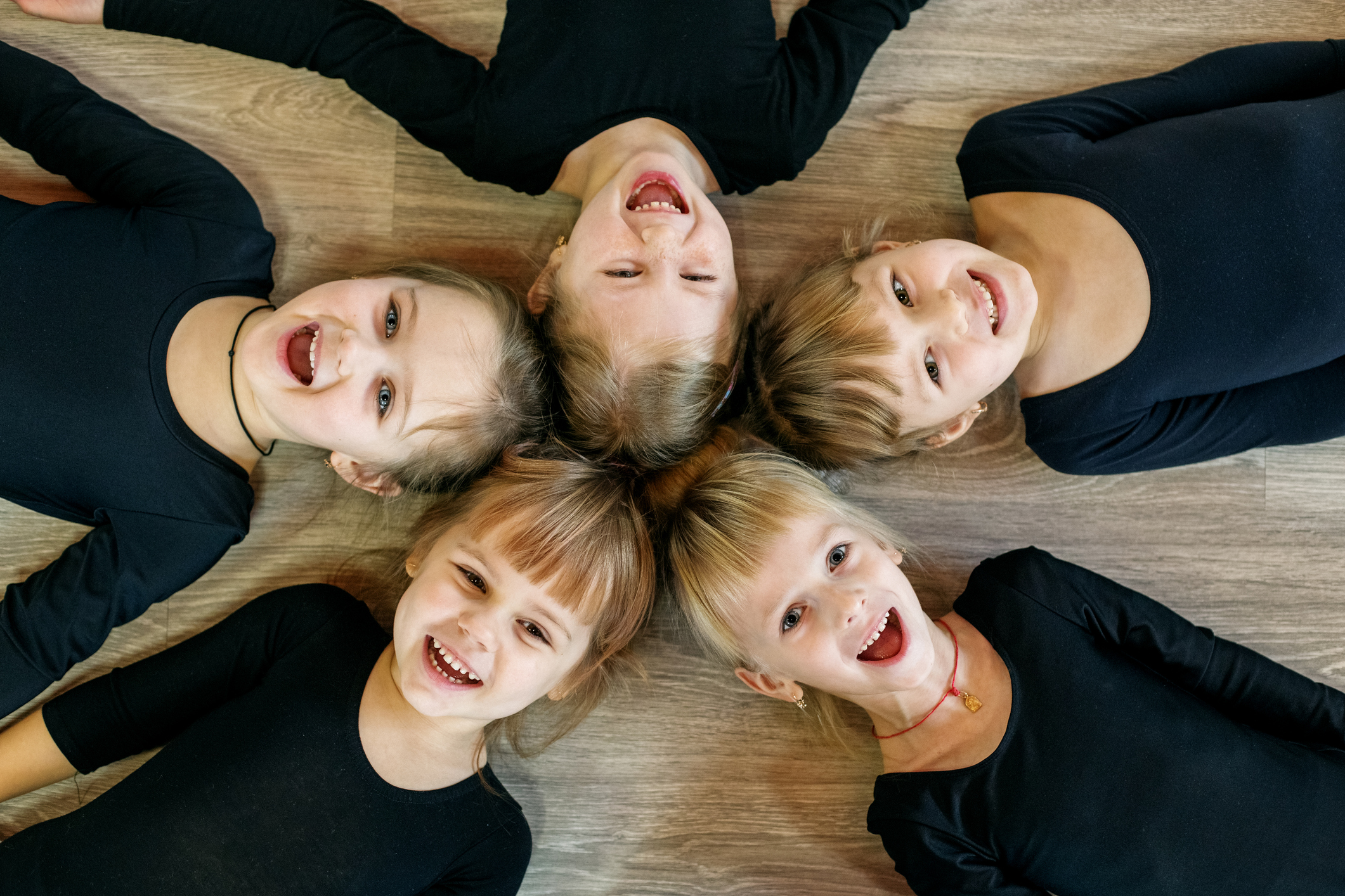 A team of young children do gymnastics in a dance class. The concept of sport, education, childhood, hobbies and dance.